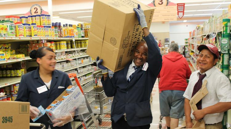 Shannon Agramonte, Pedro Berrido and Humberto Lopez restocking shelves at the Market Basket in Danvers the morning of Aug. 28, 2015, just hours after Arthur T. Demoulas and his backers won  control of the company.