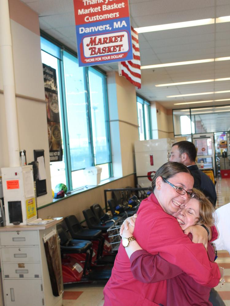 Manager Stefanie Faris hugs part-timer Maria Carreiro at the Market Basket in Danvers the morning of Aug. 28, 2015, just hours after Arthur T. Demoulas and his backers won  control of the company. Part-timers had been out of work for weeks until Carreiro and her colleagues called them early in the day to ask them to come to work.