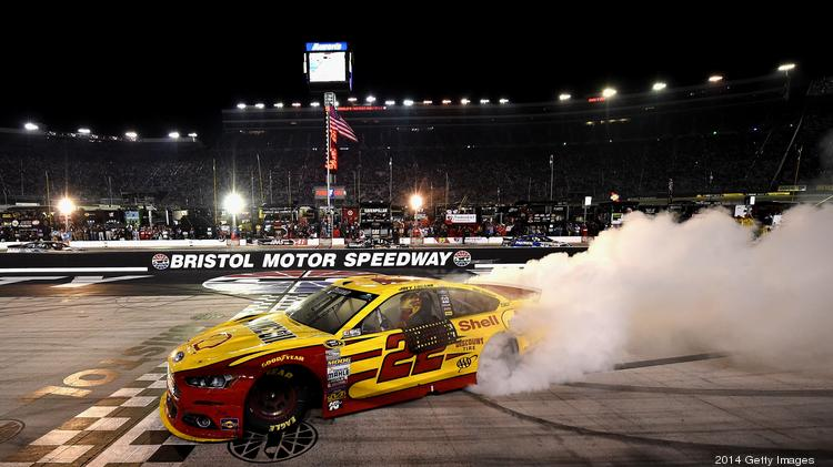 Joey Logano celebrates with a burnout after winning the NASCAR race at Bristol Motor Speedway last weekend.
