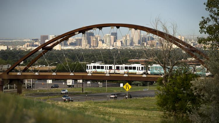 The RTD W line travels over the 6th Avenue bridge on its way to the Jefferson County Government Center/Golden station.