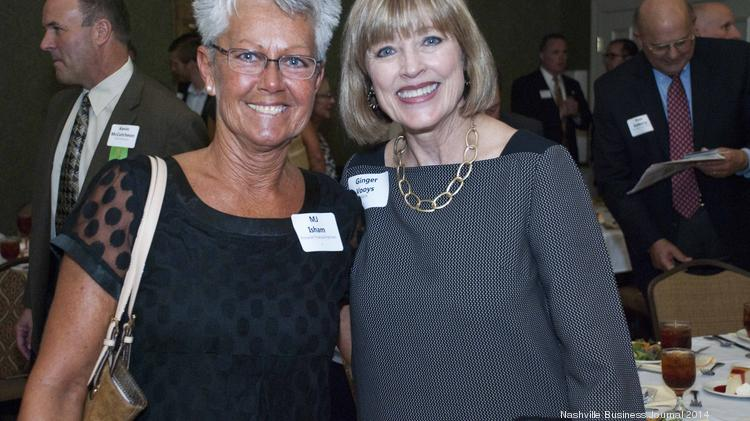 MJ Isham, of Pinnacle Financial Partners, left, with Ginger Vooys of YMCA.