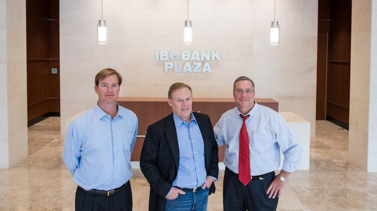 CBRE brokers Will Douglas, left, and Jerry Frey, right, represented Sizmek executive Jack Reynolds, center, in a new lease at IBC Bank Plaza.