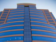 Novelly controls the Merrill Lynch Center, at 8235 Forsyth Blvd., the home of Apex Oil's headquarters.