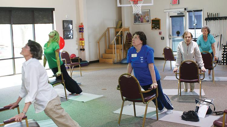 Larksfield Place residents take part in an afternoon yoga session.