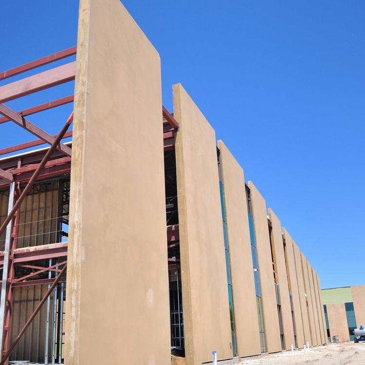 Pre-cast tilt-wall concrete panels are the primary structural element used in the project. They are both efficient and allow for creativity. What's more, they tie the expansion to the rest of the campus, which is heavy on stucco façades.