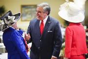 Kentucky Lt. Gov. Jerry Abramson talked to friends on Churchill Downs' Millionaires Row on Derby Day.