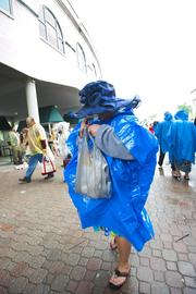 This woman was using her hat and poncho to keep herself dry.