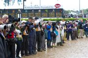 Photographers lined up on the track as the Derby contenders made their way from the backside to the front side of Churchill Downs on their way to the paddock area.