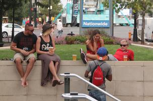 A mostly young and trendy crowd found it easy to find places to relax at the Fashion Meets Music Festival's scattered sites around the Arena District on Saturday evening.
