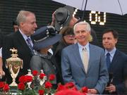 Gov. Steve Beshear waited in the Winner's Circle for the trophy and rose garland presentation.