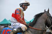 Jockey Joel Rosario rose Orb to the Winner's Circle after their win in the 2013 Kentucky Derby.