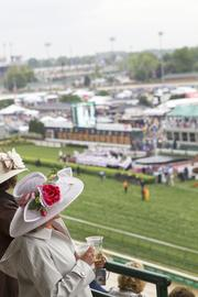 As the rain cleared up, people on Millionaires Row prepared to watch the race.