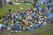 Attendees in the infield geared up for the rain on Derby Day.