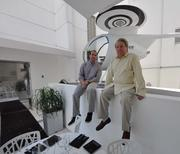 Neil Sazant, Sagamore Hotel president, and Martin Taplin with a helicopter sculture.