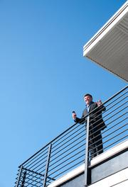 Michael Burcham talks to guests on the roof of the Entrepreneur Center during an after party.