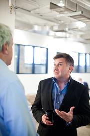 Michael Burcham talks with David Pack, left, discuss a potential partnership for the Entrepreneur Center to consider.