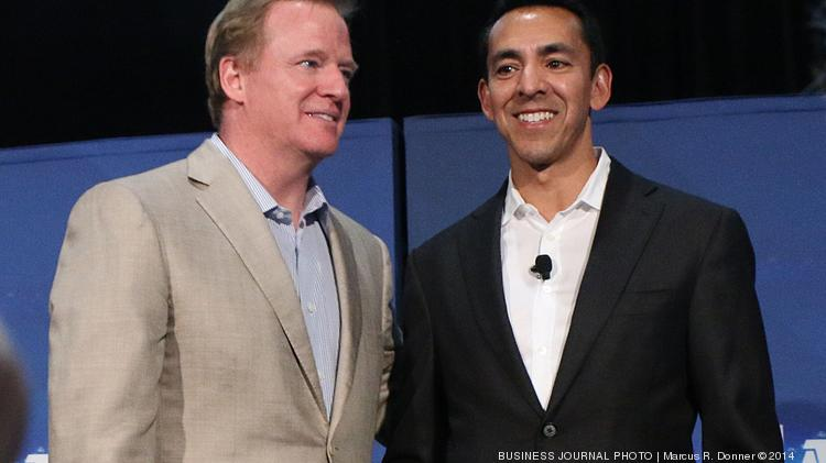 From left, NFL Commissioner Roger Goodell and Microsoft Vice President, Devices and Studios Marketing, Yusuf Mehdi talk during an NFL media event at CenturyLink Field the day before the NFL's regular season opener in Seattle.