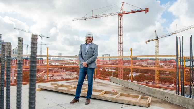 Urbanspace CEO Kevin Burns stands atop the Seaholm Residences under construction downtown, near the north shore of Lady Bird Lake.