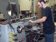 Cale Chambers operates a metal lathe at ITM in San Antonio.