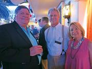 John Heekin of Cincinatti-based Source 3 Development, Greenberg Gibbons Commercial Corp. CEO Brian Gibbons and Greenberg Gibbons General Counsel Donna Sills pose at the Maryland Party 2014 in Las Vegas.