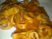 Calamari Luciano: squid in a spicy tomato sauce with onion