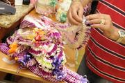 Bronson Phanphongsa, owner of Lei of the Island Flower shop in Honolulu, prepares lei for graduations and Mother's Day.