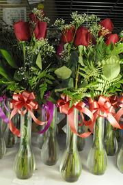 Long-stemmed roses are stored in the chiller of Lei of the Island Flower Shop in Honolulu.
