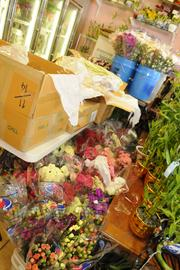 The Lei of the Island Flower Shop in Honolulu  is packed with various lei, flowers and good-luck bamboo in preparation for a busy month of graduations and Mother's Day.
