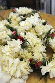 Double tuberose with rose buds lei currently cost $18 each at Lita's Leis & Flower Shop in Honolulu, but prices will fluctuate with the supply of flowers.