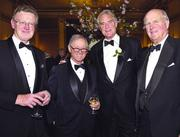 "SHEDDING LIGHT ON LITERATURE The Associates of the Boston Public Library hosted the 25th annual Literary Lights — a black tie, candle-lit dinner that pays tribute to outstanding writers from the Northeast. Pictured, from left, are: Literary Lights advisory committee member and author of ""The Lincoln Letter,"" William Martin; dinner sponsor, Lionel Spiro (he is husband of Vivian Spiro, chairwoman of the Associates of the Boston Public Library); literary agent John Taylor ""Ike"" Williams of Kneerim, Williams & Bloom; and Boston businessman and venture capitalist Bayard Henry."