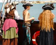 Some people touring El Galeon dressed in period costumes.