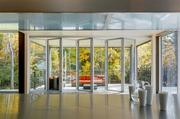 Folding glass doors open up to the patio.