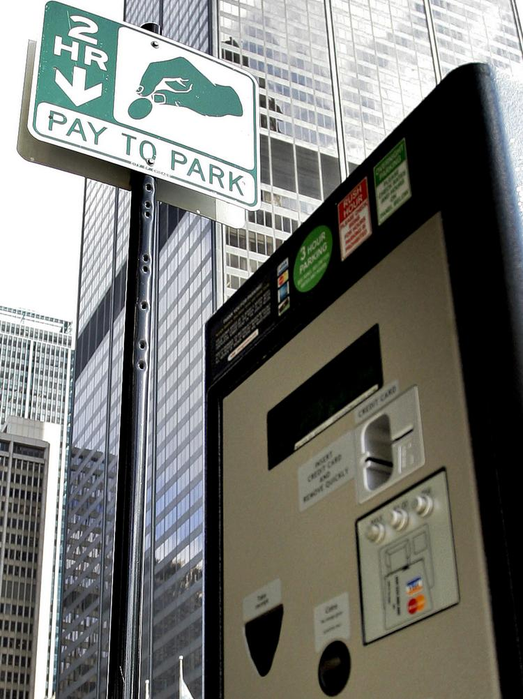 Chicagoans now use automated machines like this one to pay high fees to park on Chicago streets.