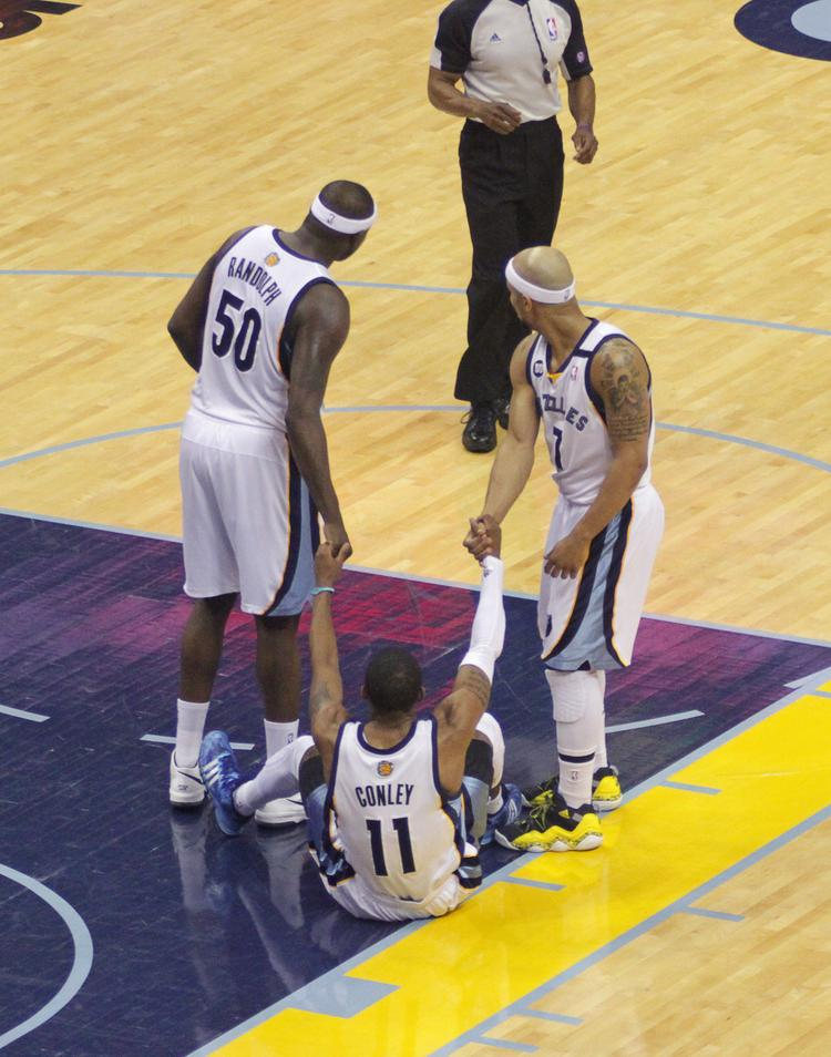 Mike Conley gets a hand up from teammates