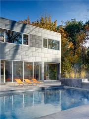 Another look at the heated pool and the zinc panels that wrap the house.