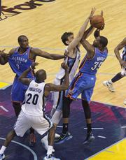 Marc Gasol contests a jump shot from Kevin Durant.