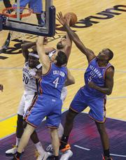 Marc Gasol goes to the basket surrounded by Thunder players