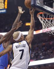 Jerryd Bayless reaches for the ball.