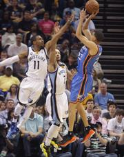 Kevin Martin draws attention from Jerryd Bayless and Mike Conley.