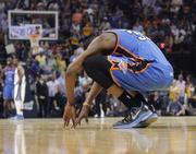 Kevin Durant crouches on the court.