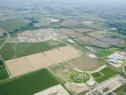 Republic Property Group has snapped up former farm land so far north, it's equidistant from the Oklahoma border and downtown Dallas. Still, the firm is betting big on its Phillips Creek Ranch in Frisco and Light Farms in Celina.