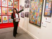 Carole Everett, communications director for the Maryland Lottery, shows a display of historical lottery tickets.