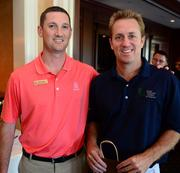 Sugar Loaf golf pro Josh Nichols with Ryan Huber, who won the longest drive prize.