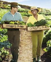 Fitness expert Bob Greene and Oprah Winfrey are seen carrying trays of vegetables grown at Oprah's Farm on Maui.