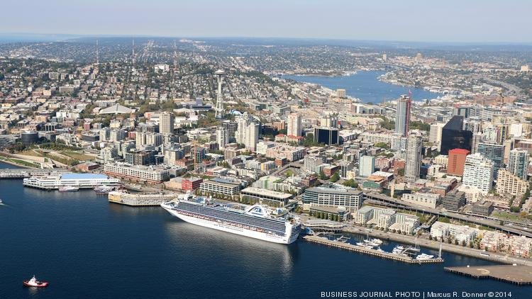 A Cruise Ship Is Docked At Pier 66 Along The Seattle Waterfront