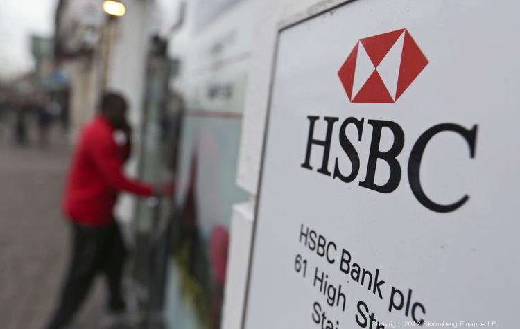 A customer enters a branch of an HSBC Holdings Plc bank in Staines, U.K. HSBC will bring its international perspective and expertise to two events for New York-area business people during June, in partnership with The Business Journals.