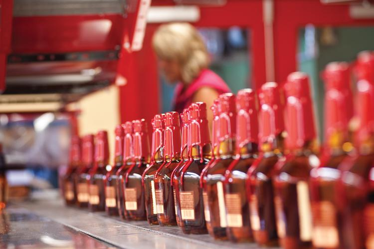 Like soldiers going off to battle, a line of freshly waxed Maker's Mark bottles head down a line to be boxed and shipped.