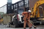 Chris Watkins, a construction worker for STI, works on site at the Artspace Mount Baker Lofts project located beside the Mount Baker light rail station in Seattle.