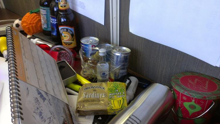 Here's what OBJ Reporter Richard Bilbao uncovered on his desk that was considered edible. Note the beer on the far left, and the sardines in the foreground in front of some mini bottles of rum.