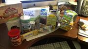 OBJ Researcher Denise Hicks had two drawers of food, one at her desk and one in a filing cabinet. She said her stock is low... She has nuts, cookies, crackers, tuna, craisins, popcorn and more. I know whose stash I'm raiding next time I work late!